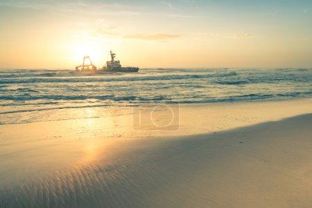 Shipwreck at sunset on the namibian Skeleton Coast - Nature wond
