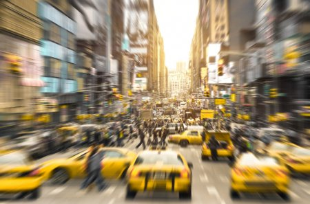 Photo for Rush hour with yellow taxi cabs and melting pot people on 7th av. in Manhattan downtown before sunset - Bright blurred defocused postcard of New York City and his crowded traffic jam - Royalty Free Image