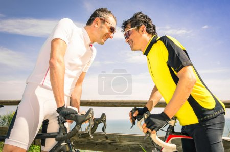 Sport challengers ar bike race - Bicycle competition international world championship - Concept of challenge and loyalty together against doping issues - Two bikers facing each other