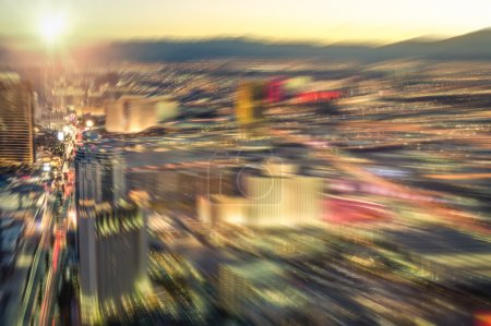 Aerial view of Las Vegas skyline at sunset - Blurred city lights from downtown strip boulevard - Vintage filtered look with radial zoom defocusing