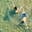 Unidentified children swimming and having fun in N...