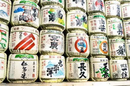 TOKYO - MARCH 2, 2015: barrels of sake wrapped in straw in Yoyogi Park near Meiji Shrine. The alcoholic beverage of Japanese origins made from fermented rice has a brewing process similar to beer.