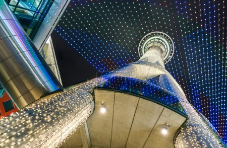 AUCKLAND, NEW ZEALAND - MARCH 05, 2015: bottom view of the world famous Sky Tower; with its 328 meters from ground level to the top, it's the tallest man-made building in the southern hemisphere