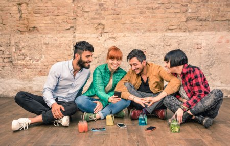 Group of hipster best friends with smartphones in grungy alternative location - Young entrepreneurs people resting at cocktail bar renovation - Friendship fun concept with trend technology interaction