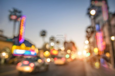 Photo for Defocused blur of Hollywood Boulevard at sunset - Bokeh abstract view of world famous Walk of Fame in California - United staes of America wonders - Emotional saturated filter with powered sunshine - Royalty Free Image