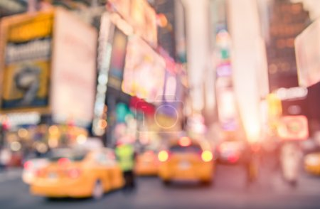 Traffic jam with defocused yellow taxi cabs and rush hour on Times Square in Manhattan downtown at sunset - Blurred bokeh postcard of New York City on a vivid bright marsala color filtered look