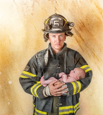 Fireman holding baby