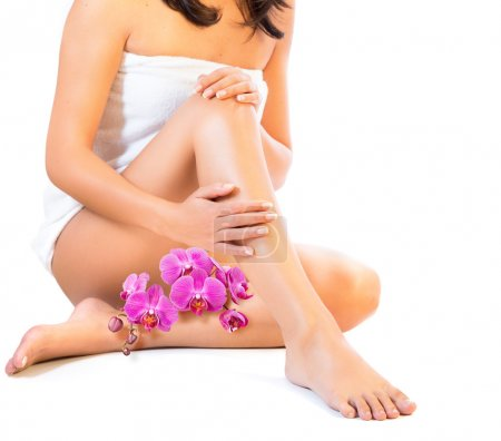 Photo for Body and care legs with orchids - Royalty Free Image
