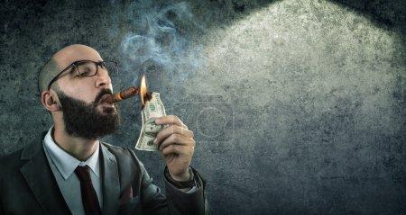 Photo for Money burning - businessman arrogant - Royalty Free Image