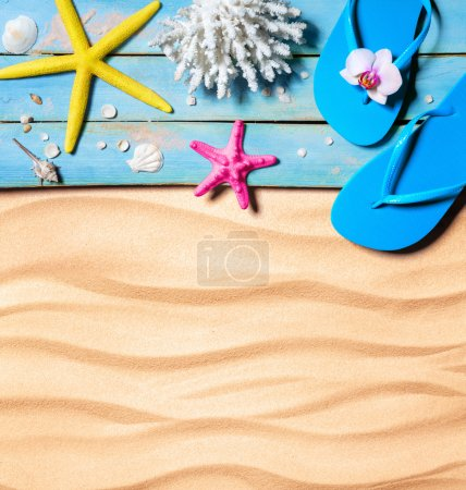 Photo for Flip-flop, starfish, seashells and coral on wooden and sand as beach background - Royalty Free Image