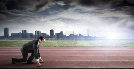 Photo for Business start - businessman on track ready for sprint - Royalty Free Image