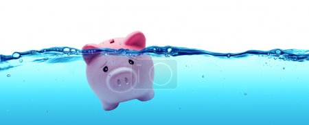 Photo for Piggy bank drowning in debt - savings to risk - Royalty Free Image