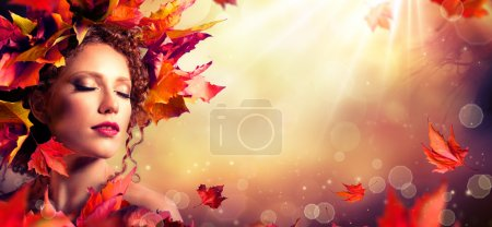 Photo for Autumn fantasy girl - Beauty fashion model with red leaves and sunlight - Royalty Free Image