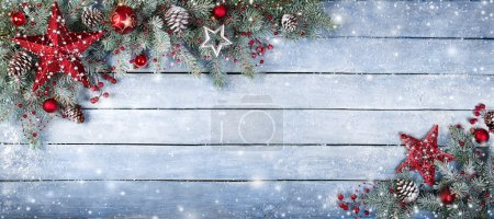 Christmas Fir Tree On Wooden Background With Snowflakes