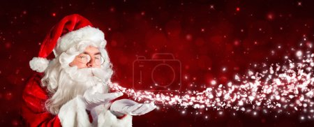 Photo for Santa Claus Blowing Snow - Royalty Free Image