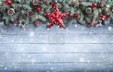 Photo for Christmas Greeting Card - Fir Branch And Decoration On Snowy Plank - Royalty Free Image