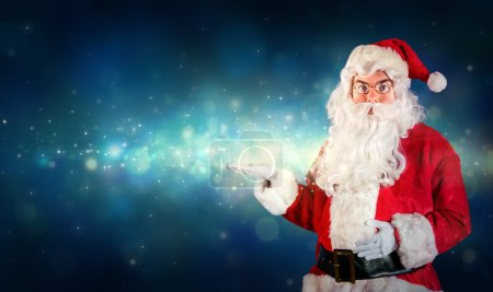 Photo for Santa Claus Showing With Hand Something Magical - Royalty Free Image