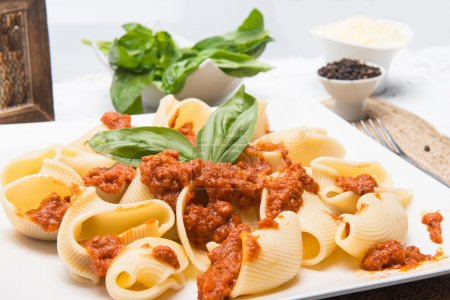 macaroni with meal and green basil