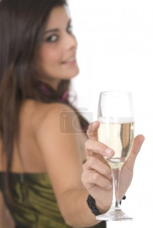 Beautiful woman with glass with champagne at a new year party