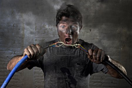 Young untrained man joining electrical cable suffe...