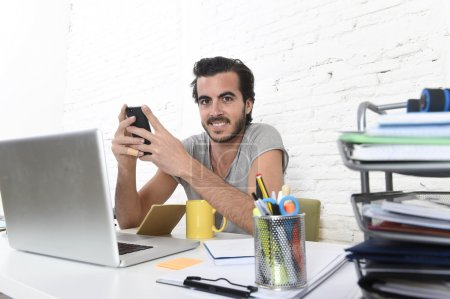 young modern hipster style student or businessman working using mobile phone smiling happy
