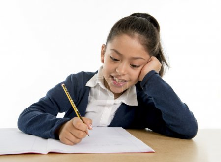 happy latin little girl with notepad smiling in back to school and education concept