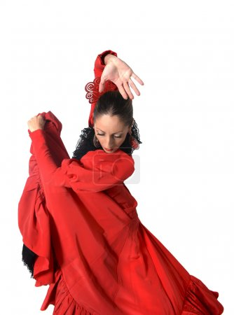 Photo for Young Spanish woman dancing Sevillanas and Flamenco wearing typical folk red dress in traditional Dance of Spain concept isolated on white background - Royalty Free Image