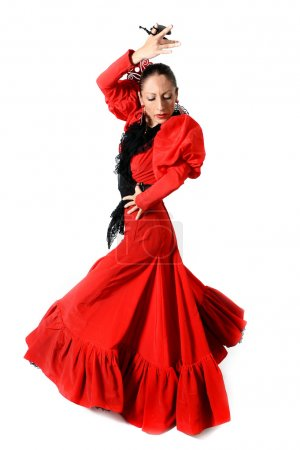Photo for Young Spanish woman dancing Sevillanas with castanets in hands wearing typical folk red dress in flamenco dance of Spain concept isolated on white background - Royalty Free Image