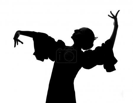 Photo for Silhouette of Spanish woman Flamenco dancer dancing Sevillanas in gypsy dress and comb in traditional Dance of Spain concept performing show isolated on white background - Royalty Free Image