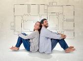 Junges paar träumen und imaging-ihr neue Haus in realen Zustand-Konzept