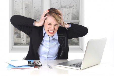 Photo for Young attractive businesswoman frustrated and desperate expression at office working on computer laptop in stress at work concept screaming angry with sad rainy window view - Royalty Free Image