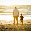Young happy father holding holding hand of little ...