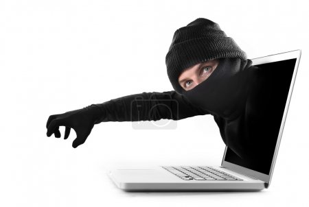 hacker and cyber criminal man out computer screen with grabbing and stealing conceptual password hacking and cyber crime