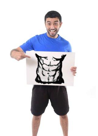 sport man holding billboard with six pack abdomen draw advertising marketing of gym fitness club