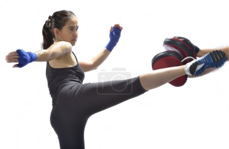 Photo for Woman practicing Thai boxing technique.(muay Thai) - Royalty Free Image