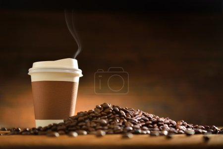 Photo for Paper cup of coffee with smoke and coffee beans on old wooden background - Royalty Free Image