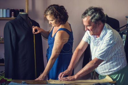 Photo for Mature couple working together on a tailoring - Royalty Free Image