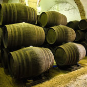 Barrels of wine or whiskey stacked in the winery