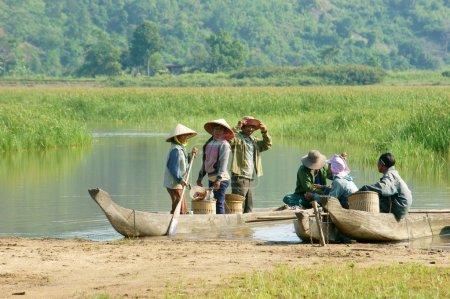 Asian farmer, row boat, family, go to work