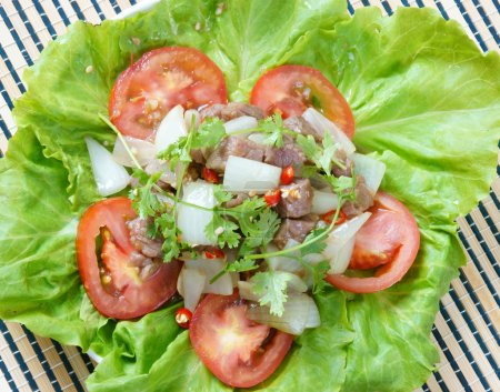 Photo for Vietnamese food, bo luc lac, nutrition and delicious eating, beef fry with spice, onion, garlic, eat with salad, tomato, cooked rice - Royalty Free Image