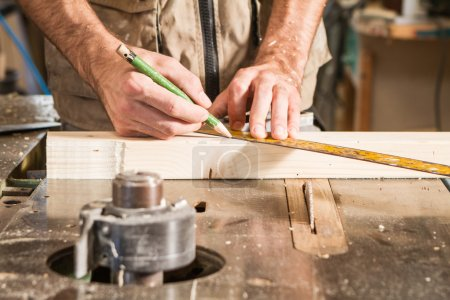 Photo for Carpenter mark a wood plank - Royalty Free Image