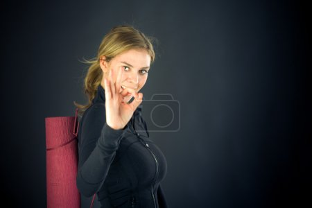 Woman gesturing ok sign