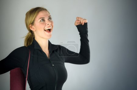 Woman celebrating success with fists up
