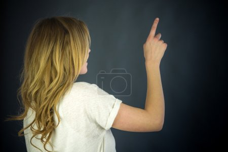 Woman back pointing by finger