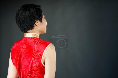 Woman looking behind