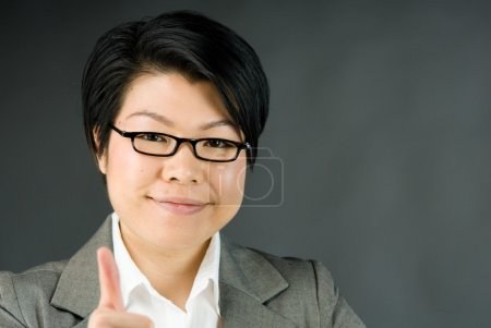 Woman gesturing thumb up sign