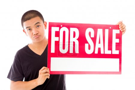 Model holding a For sale sign