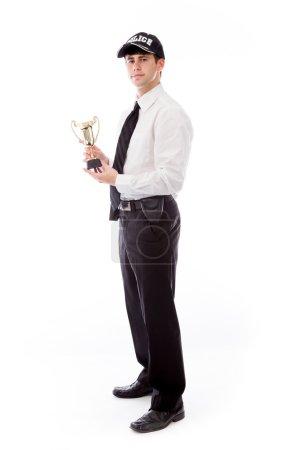 Photo pour Un policier tenant un trophée isolé sur fond blanc - image libre de droit