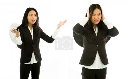 Asian young woman dressed as devil scolding to another isolated on white background