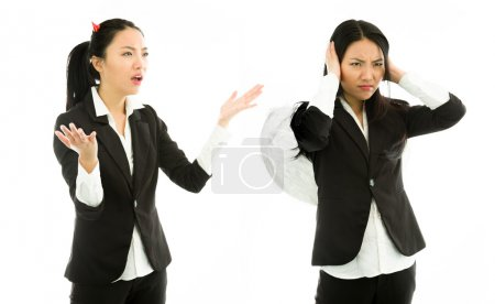 Devil side of a young Asian businesswoman scolding angel side isolated on white background